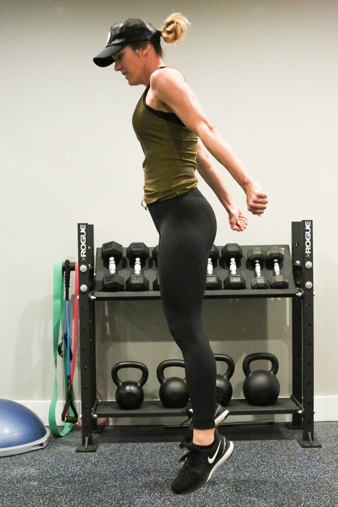 a woman completing a jump squat