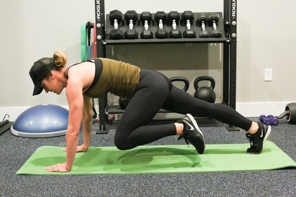 a woman completing mountain climbers