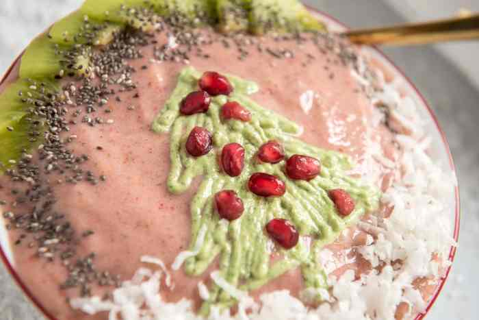 close up shot of a pink smoothie bowl with a green christmas tree topping