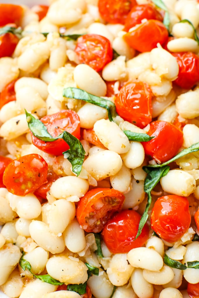 close up shot of White Beans with Tomatoes and Fresh Basil