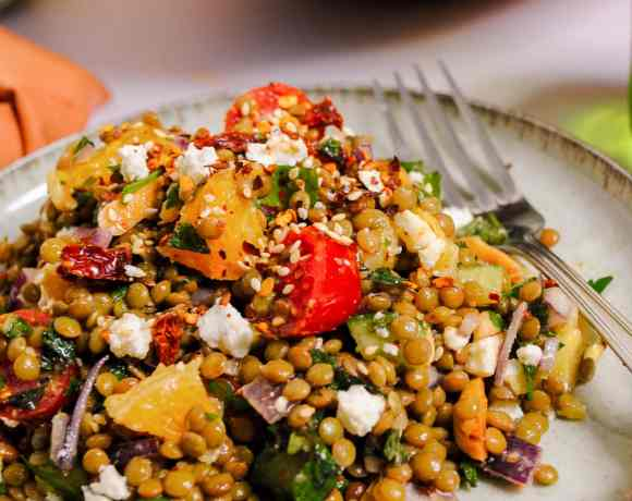 Lentil salad recipe on a plate with a fork
