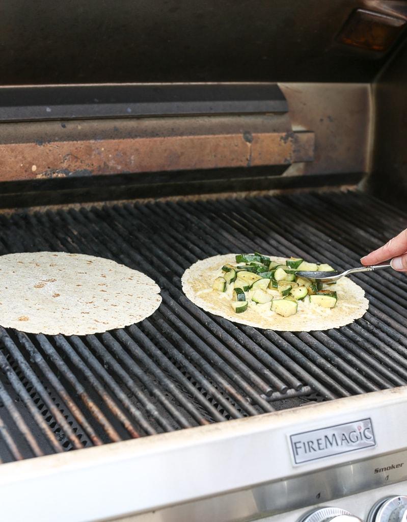 adding zucchini to tortilla