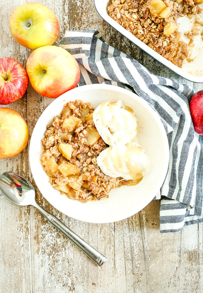 healthy apple crisp recipe vegan and gluten-free with apples and a striped napkin