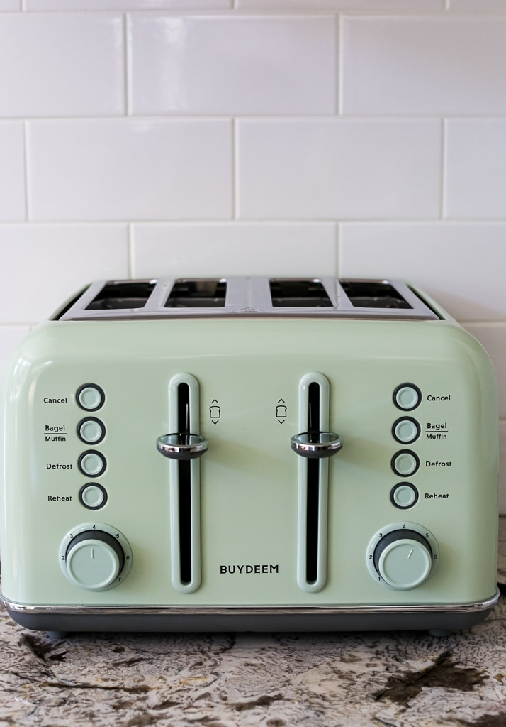 a mint green toaster close up