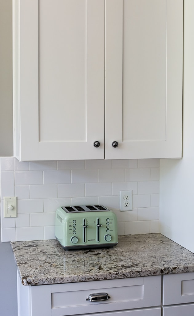 a mint green toaster on a counter