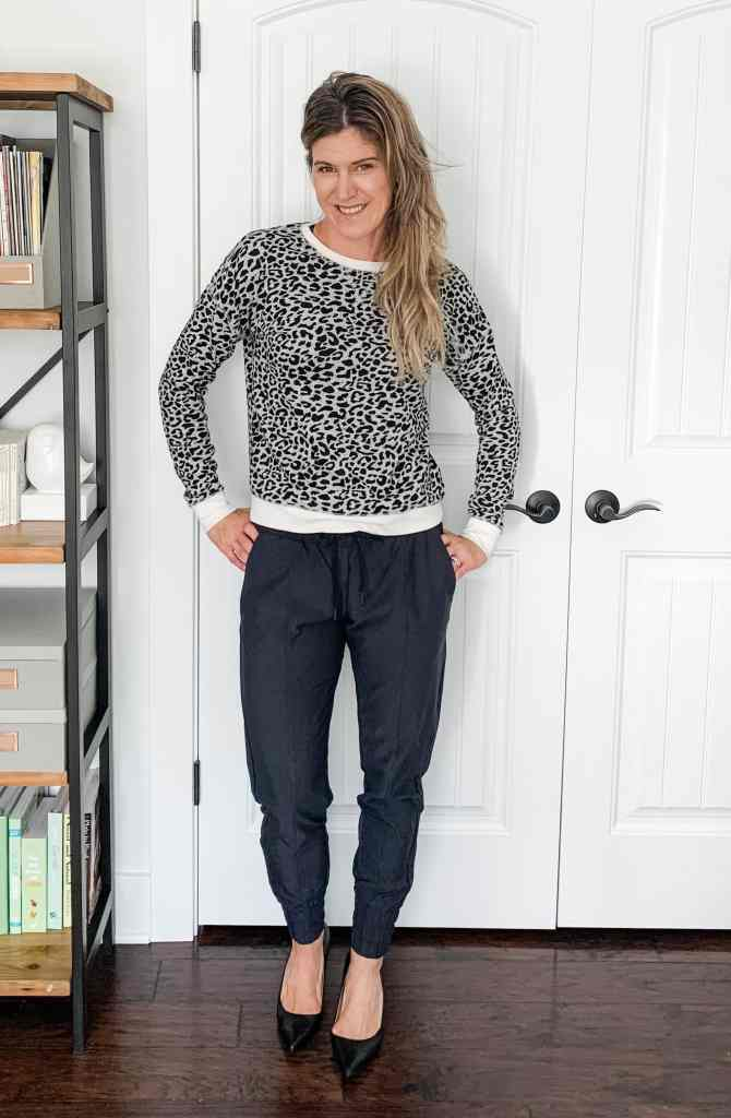 A woman in joggers with heels