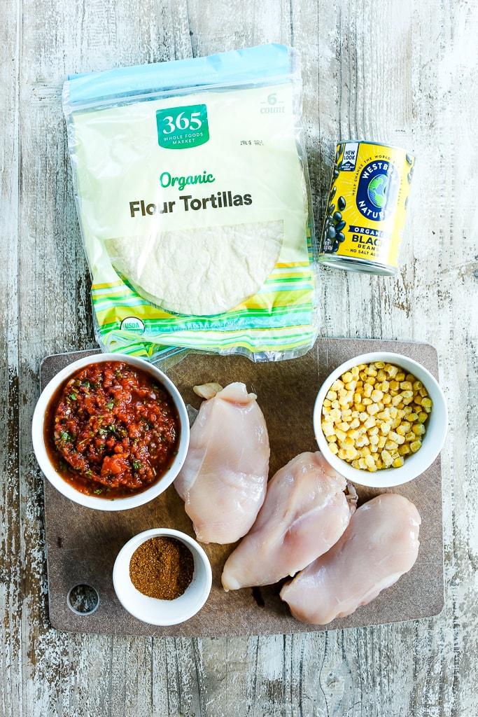 Crockpot Chicken Tacos Recipe chicken breasts, black beans, corn, salsa, seasonings, and tortillas