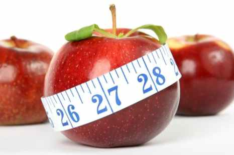 Apple with a Tape Measure Around it for a 100 Calorie Snack to Maintain Weight