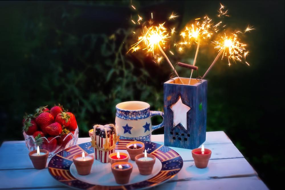 Staying Fit Over the 4th of July Sparklers with Red White and Blue Candles and Strawberries