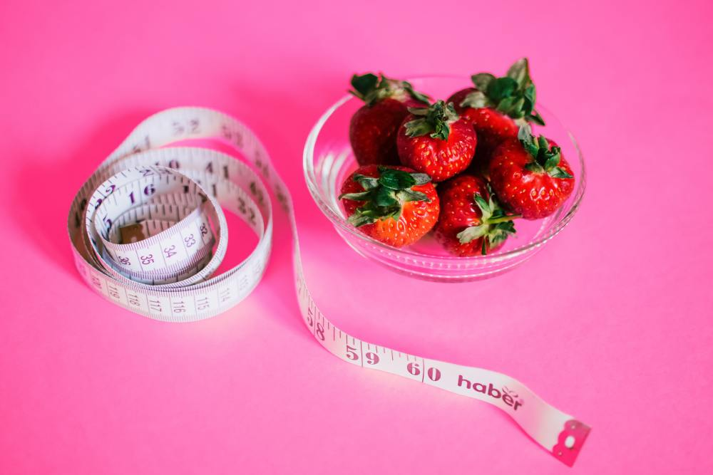 Bowl of Strawberries and a Tape Measure