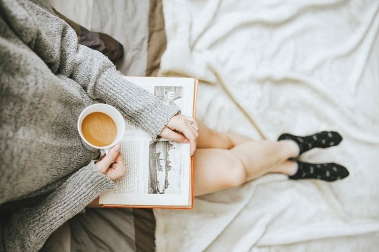 Reading a Book with Coffee for Self-Care