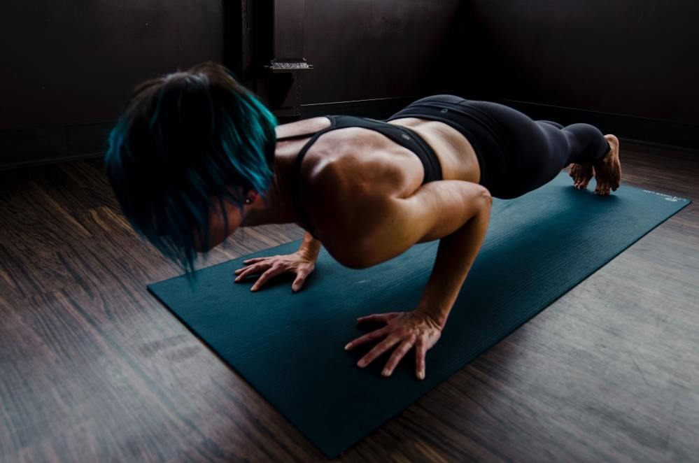 Woman Doing Pushup - 7 Minute Workout Exercises