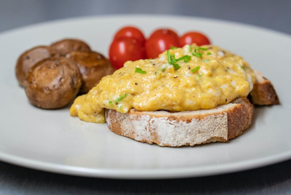 Scrambled Eggs on Toast with Tomatoes and Mushrooms