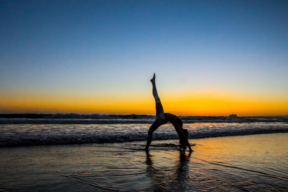 Woman Bending on a Beach- Benefits of Lunges