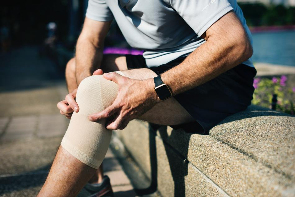 Man With Knee Wrap On