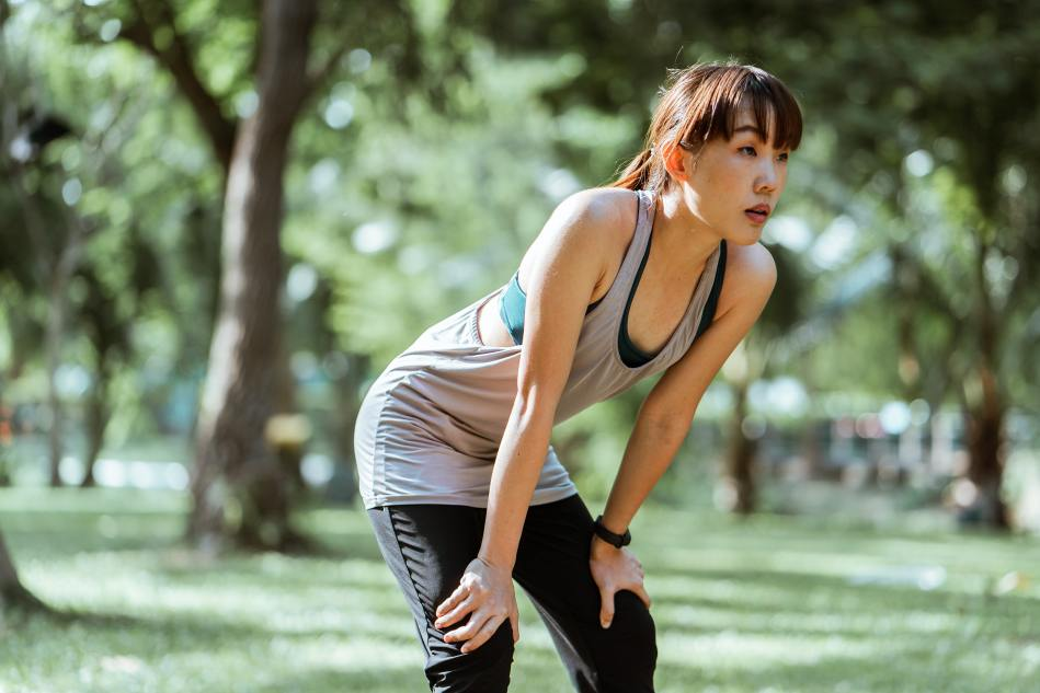 Burpees Exercise Builds Endurance- Woman Catching Her Breath