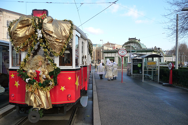 Vienna tram with Christmas decoration at the Karlsplatz