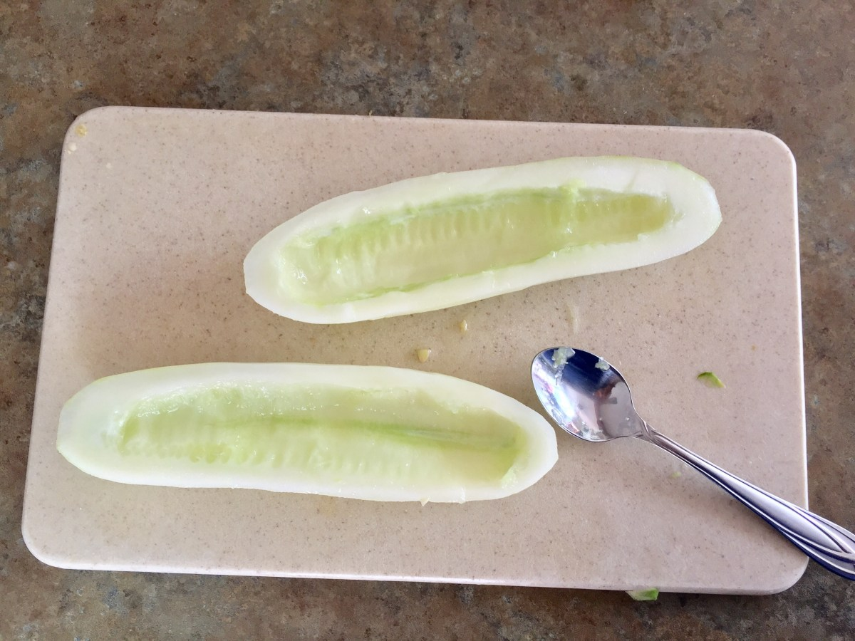 Seeded cucumbers on a cutting board.
