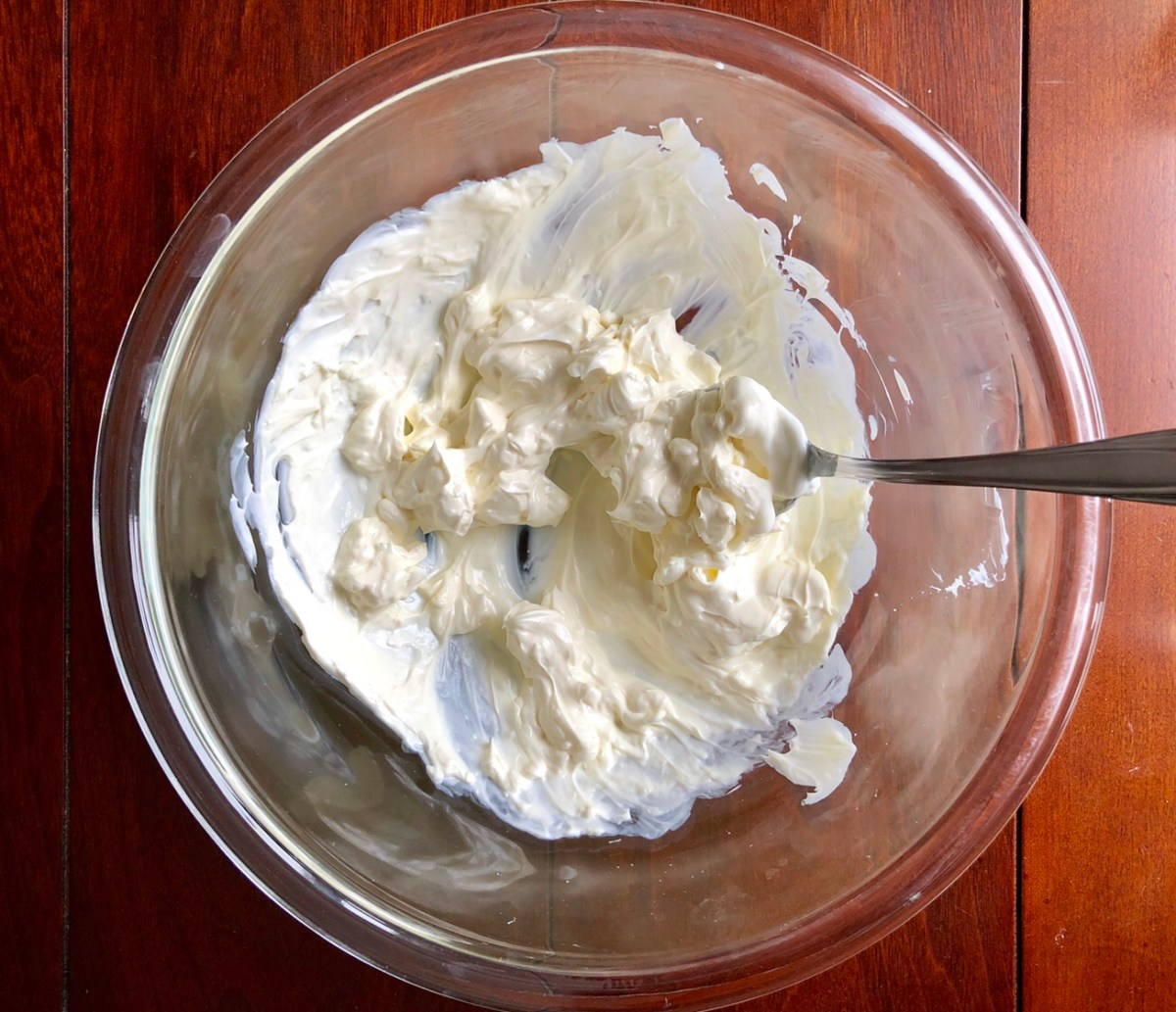 Heat cream cheese in a microwave safe bowl for 1 minute.