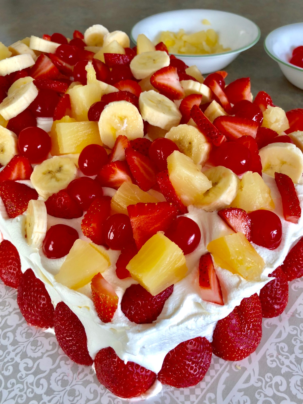 Keep adding fruit until the cake is completely covered.