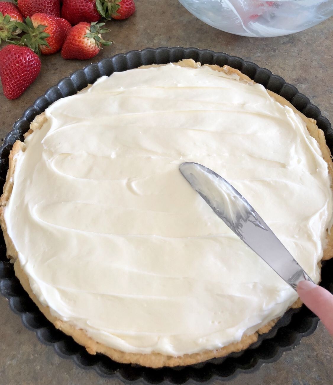 Spread the cream cheese mixture over the chocolate layer. #tart #dessert #summerdessert #memorialdaydessert #fruittart
