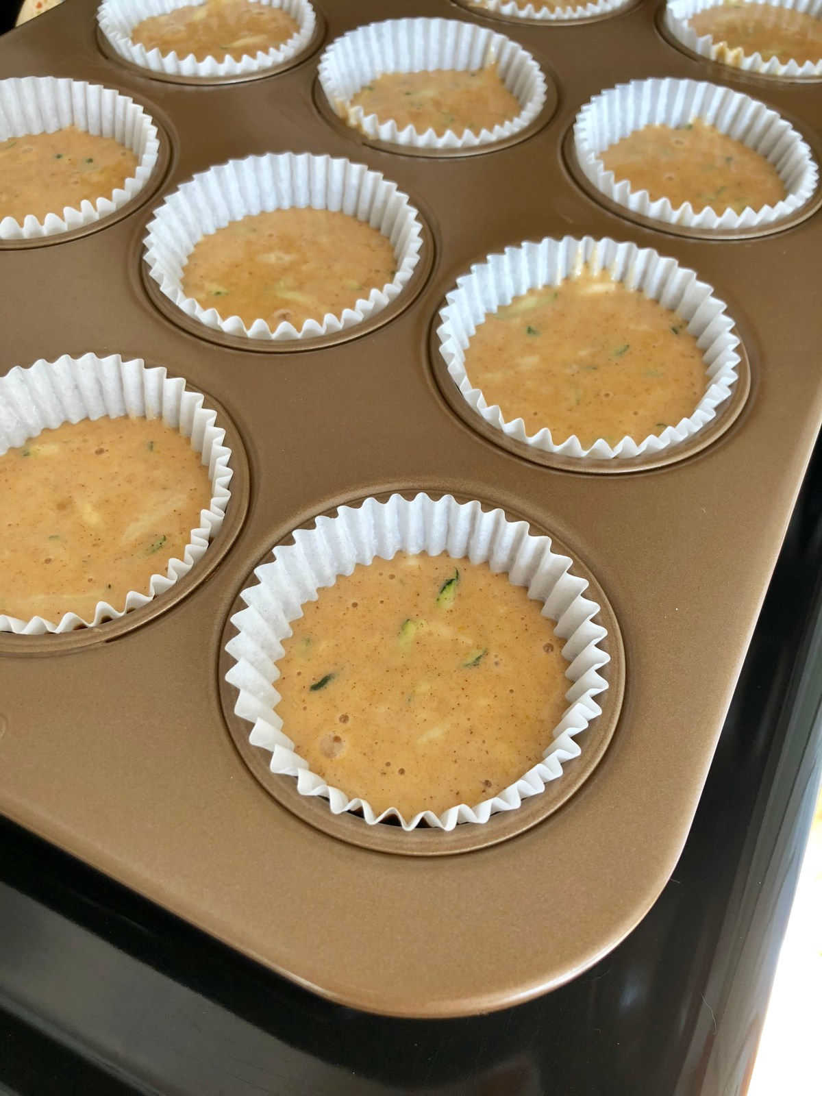 Frosted Zucchini Cupcakes by Happylifeblogspot.com #zucchinirecipes #zucchinicupcakes #spicecupcakes #fallrecipes #zucchini