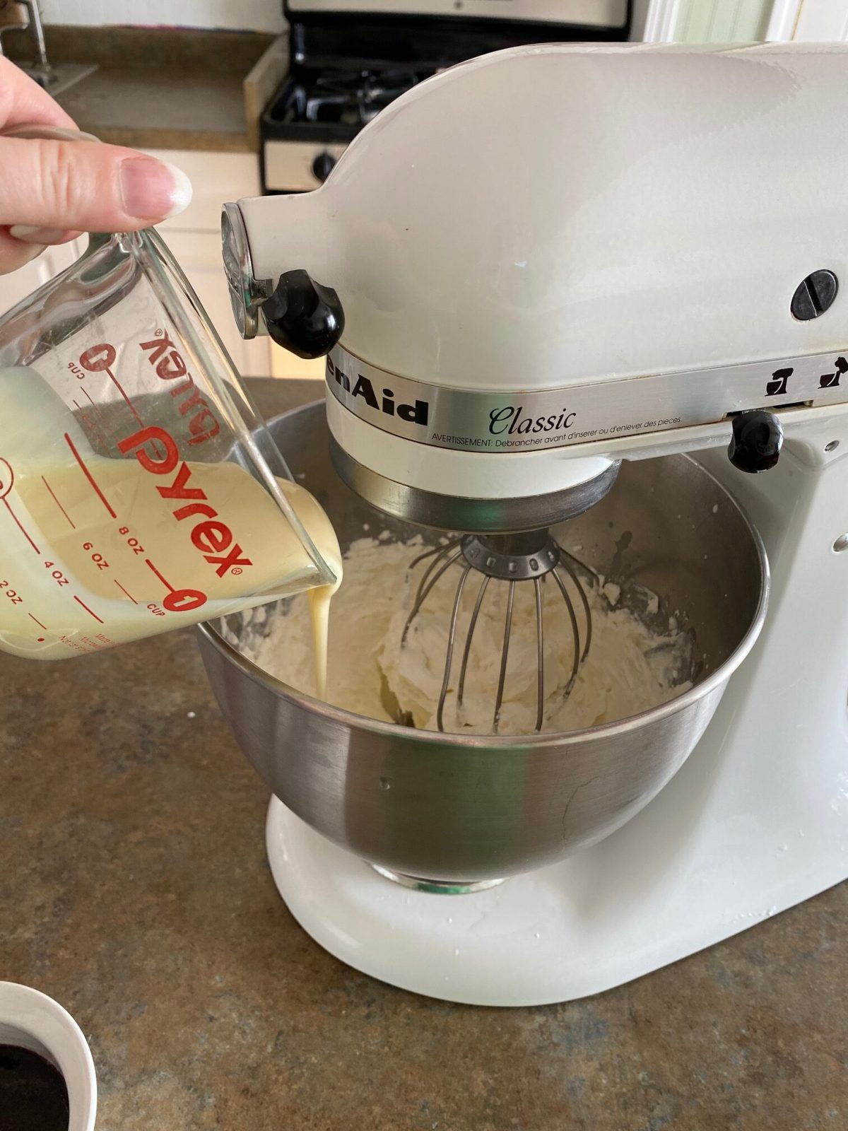 Cream cheese, heavy cream and sweetened condensed milk are added to a stand mixer. #blackberrycheesecakeicecream #nochurnicecreamrecipe #icecreamrecipes #blackberryrecipes #homemadeicecream