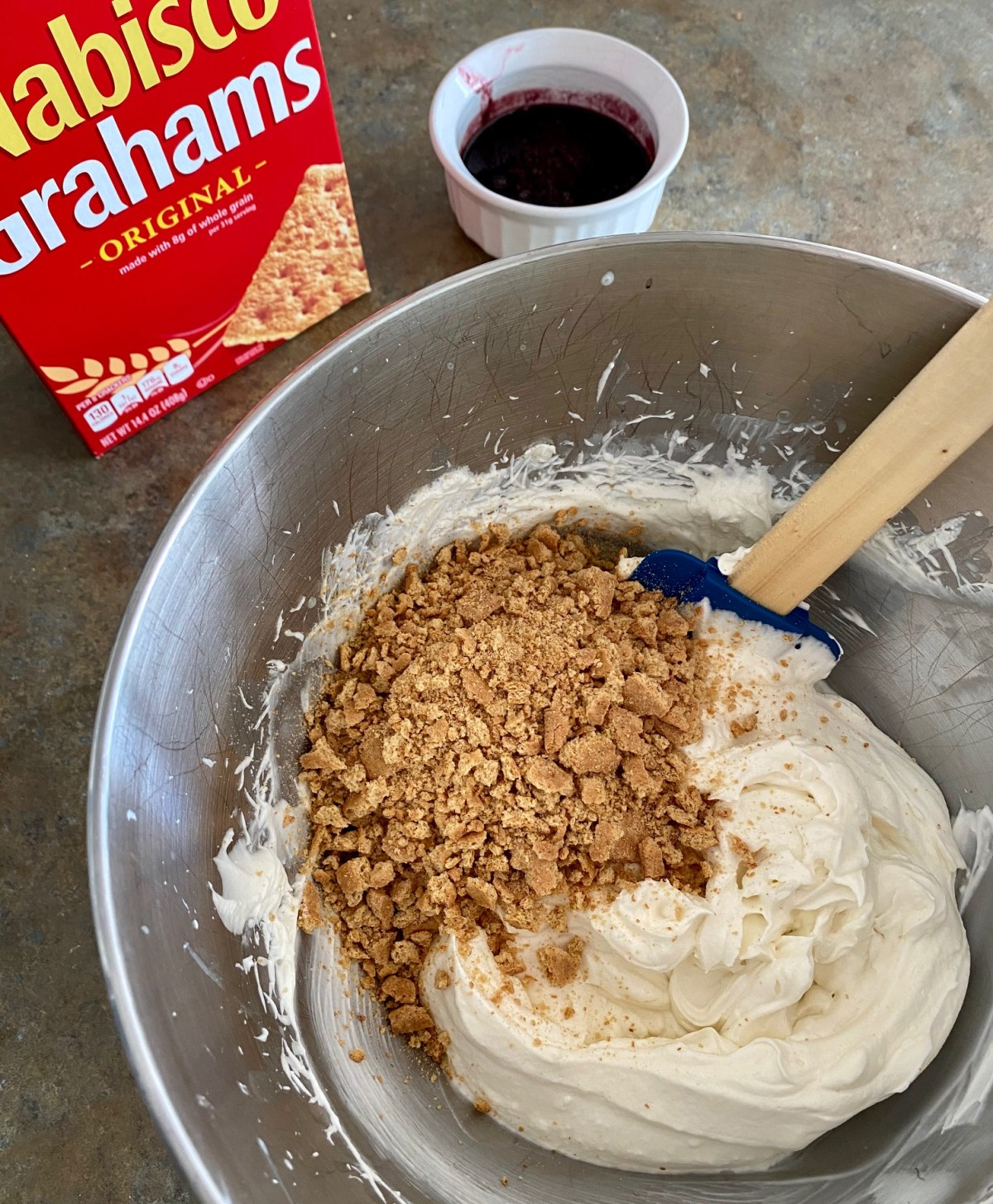 Graham cracker pieces folded into the ice cream base. #nochurnicecream #icecreamrecipeswithoutanicecreammaker #icecreamfromscractch #howtomakeicecream #easyicecreamrecipe