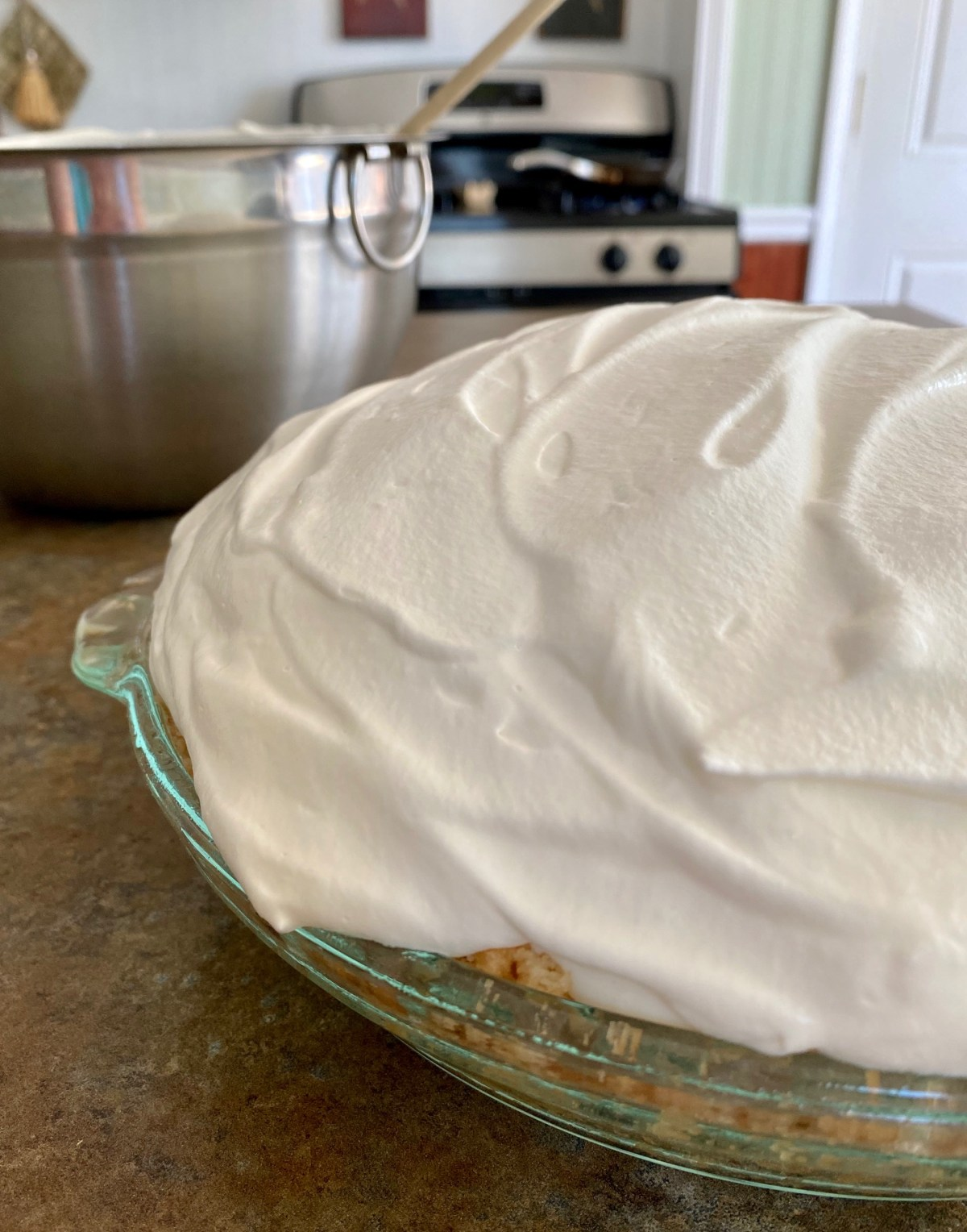 Whipped cream is spooned over the cream pie filling. #keylimepie #keylimecreampie #summerdessert #summerrecipes #nobakepie #nobakedessert