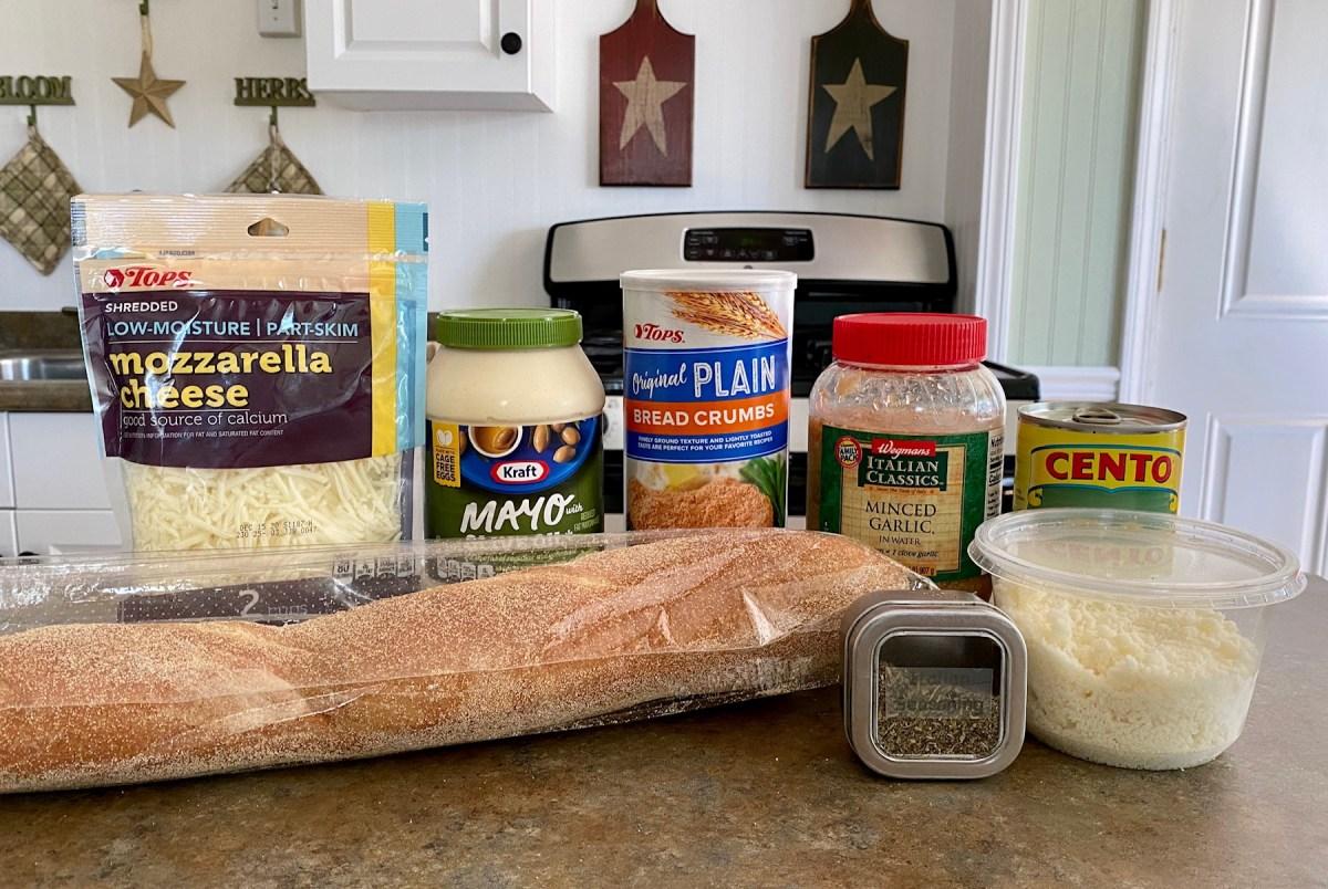 Easy Artichoke Bread list of ingredients #artichokebread #bread #garlicbread #artichokespread #appetizerrecipes #easyrecipes #dinnerparty