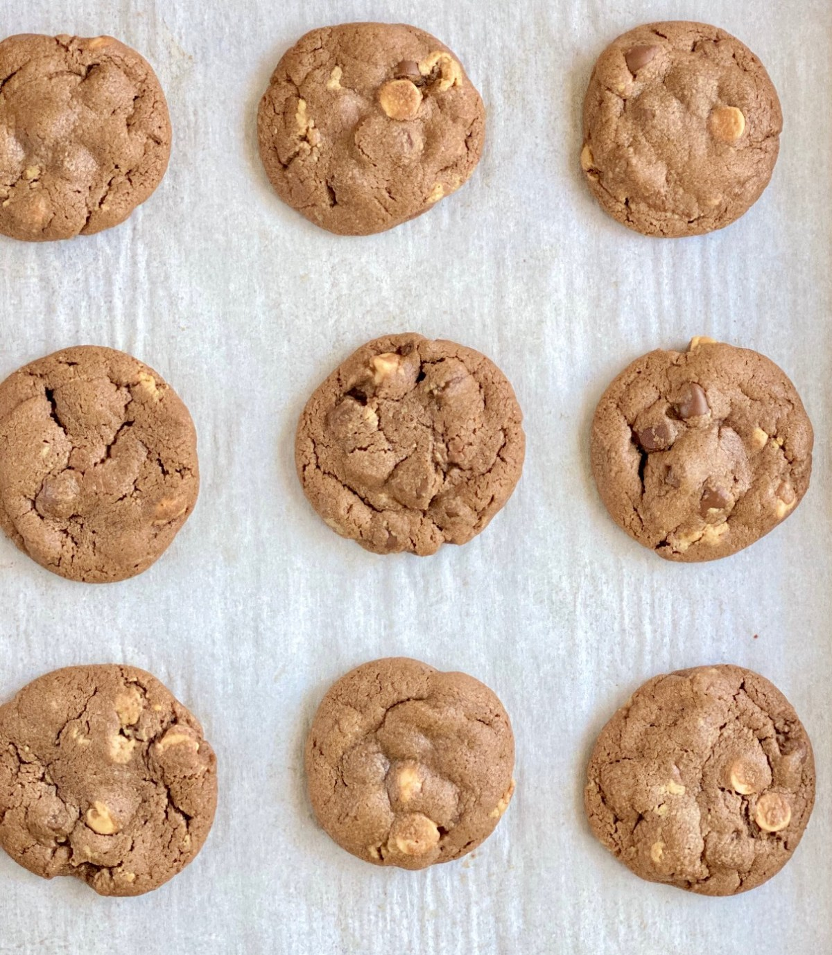 Chocolate Peanut Butter Cup Cookies fresh out of the oven. #chocolatepeanutbuttercupcookies #peanutbuttercupcookies #cookierecipes #christmascookies #bestchristmascookies #christmascookierecipes #peanutbuttercuprecipes