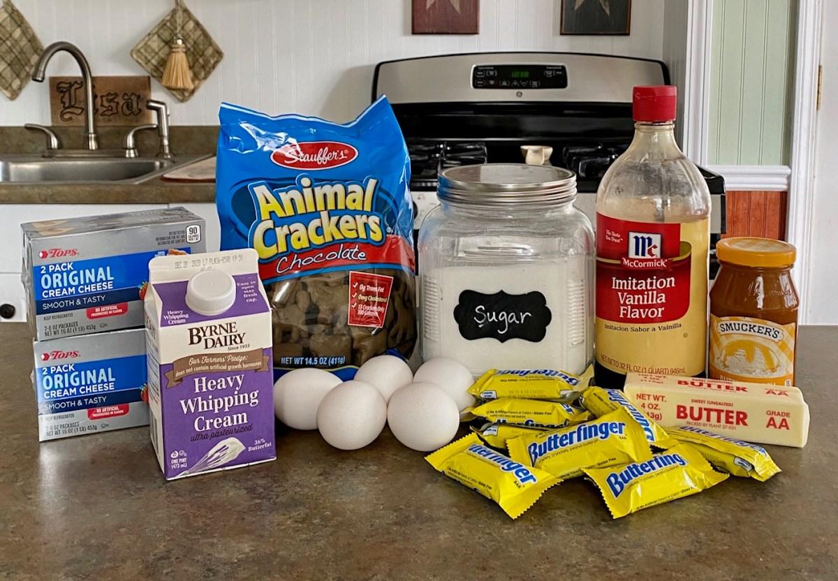 Butterfinger Cheesecake ingredients list #cheesecake #butterfingercheesecake #butterfingerrecipes #dessert #leftoverhalloweencandyrecipes #thanksgivingdessert #holidaydessertideas