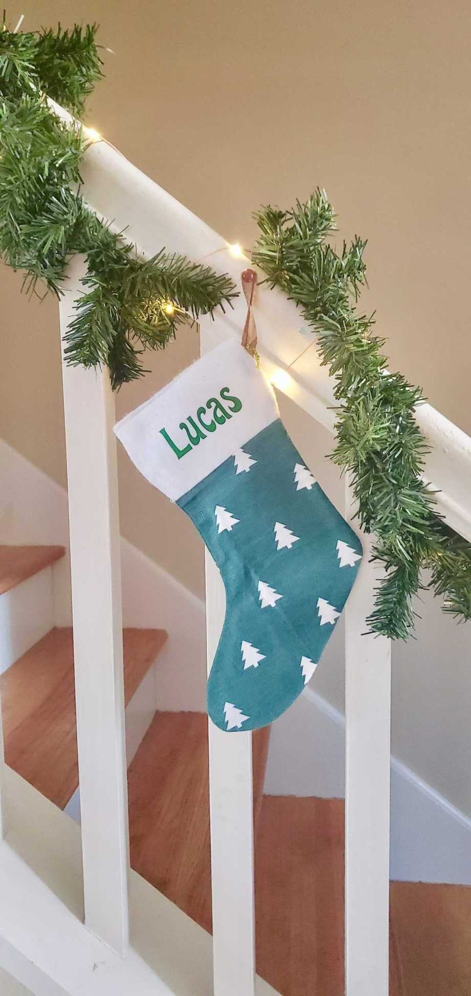 Photo of stocking hanging on stair rail