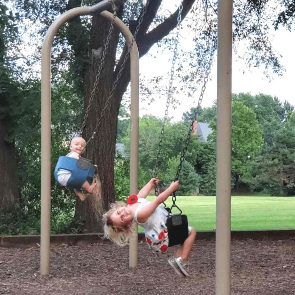 PIcture of 2 kids swinging