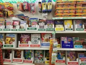 15 fun road trip games, ideas and travel accessories for kids on your next family vacation. Save money with fun things to do from the Dollar Store like Disney toys, busy bags, & scavenger hunts, All fun travel activities for car rides or plane rides. Use these family travel tips for an unforgettable vacation! #roadtripgames, #familyvacation, #dollarstore, #traveltips