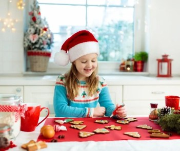 Baking holiday cookies together for Christmas.