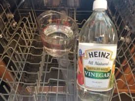 How to Clean a Dishwasher with Vinegar. Quick cleaning hack to disinfect your dishwasher using 2 cups of Vinegar. #cleaninghack #cleaningtip #vinegar #dishwasher #cleandishwasher