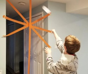 Airplane toss is a fun indoor activity for kids at home with streamer and paper airplanes. An easy DIY Game kids will love to play.