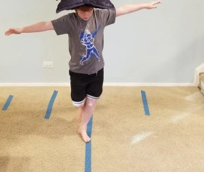 Keep kids busy at home with a balance beam on your floor. A fun kids activity they'll love.