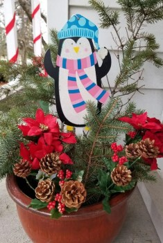 Cheap Christmas Porch Decorations with outdoor Holiday pots made with Dollar Tree Items. #christmas #Porchdecorations #holidaypots #holidaydecorations #outdoorchristmasdecor