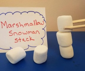 Fun Party Game Marshmallow Snowman Stack Minute to Win It Game. Perfect for Holiday parties for kids at school or home.