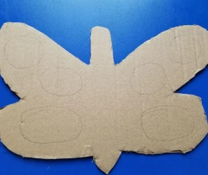 How to make an easy butterfly craft for kids with cut outs to create the wings.