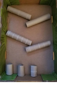 Create your Marble Run layout with cardboard tubes. A fun cardboard science experiment at home.