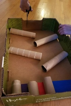 Cut a hole in your Marble Run Board to drop your marble for this fun STEM experiment at home.