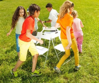 Musical Chairs is a fun birthday party game for kids both indoors & outdoors.