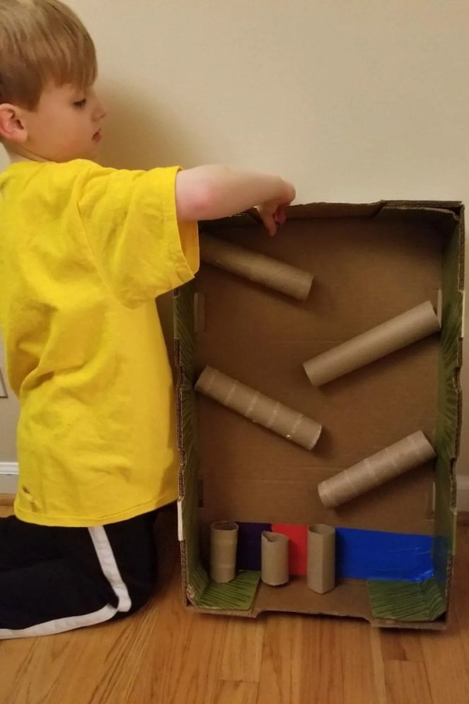 STEM Activity for Kids Cardboard Marble Run Ideas. Recycle your cardboard and make this fun cardboard toy with boxes, paper towels, toilet paper rolls and glue. A fun science experiment at home.