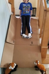 Fun Cardboard Slide Ideas for Kids. Create a cool indoor slide using cardboard boxes and your stairs. Great rainy day activity for kids.