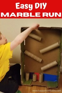 DIY Cardboard Marble Run for kids. Use cardboard boxes and tubes to make a fun STEM experiment kids will love. Great kids activity with reusable cardboard.
