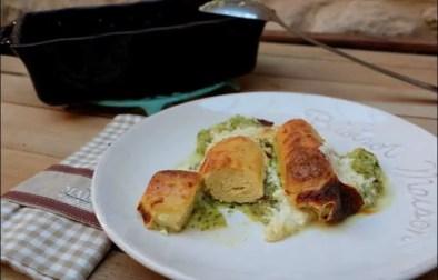 gratin de quenelles de brochet sur lit de courgettes et crème de parmesan