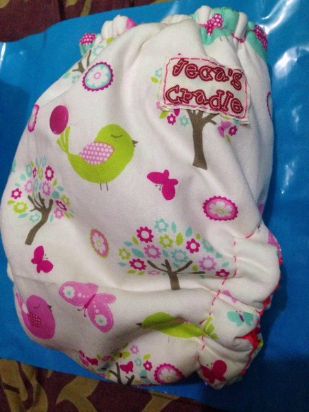 Jeca's Cradle's Hybrid Fitted Cloth Diapers.